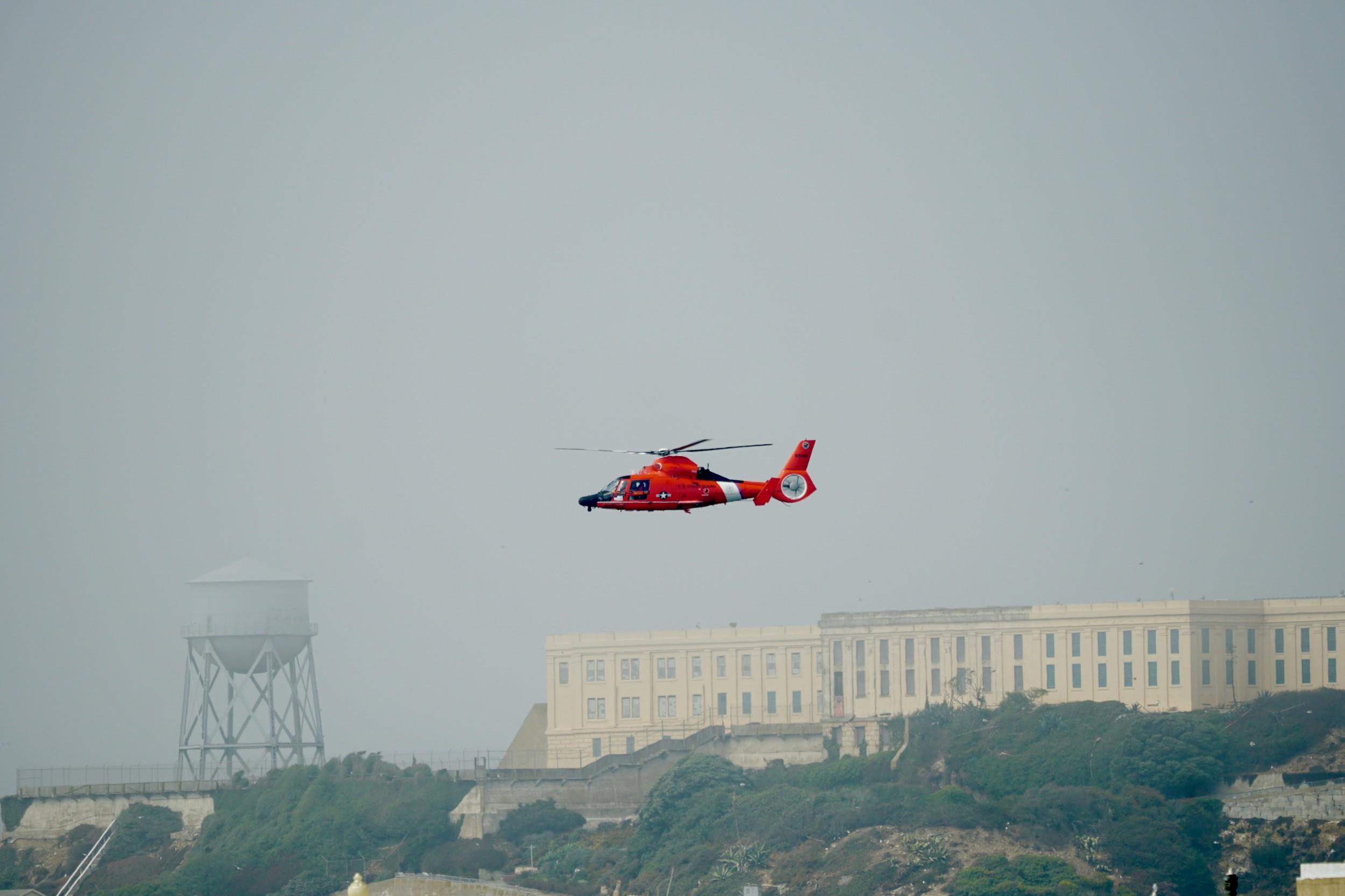 USCG Helicopter passes Alcatraz